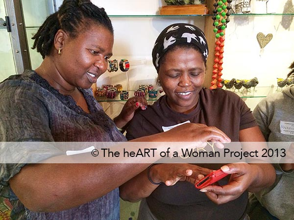 """The heART of a Woman Project mobile photographers at eKhaya eKasi in Khayelitsha, South Africa learn """"pinching"""" on the iPhone."""